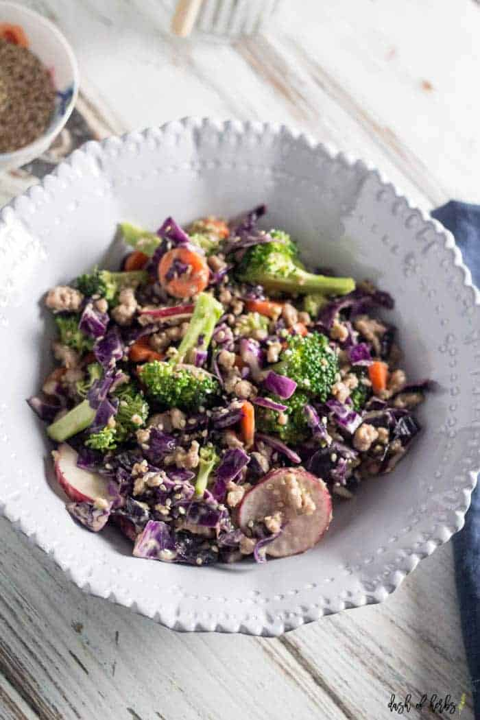 An overhead image of the Asian Chopped Salad with Turkey recipe in a decorative cream ceramic bowl.  This image is a close up of the recipe.